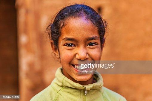Beautiful Muslim girl in Moroccan kasbah