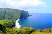 Beautiful natural scenery of Hawaii, steep hill and cliff down to the sea. Epic natural panorama and scenery of Hawaii.