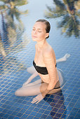 Beautiful natural Woman relaxing in a SPA Pool