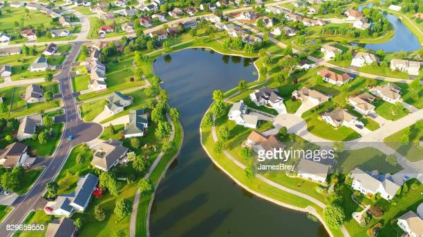 Beautiful neighborhoods around man-made lake, aerial view