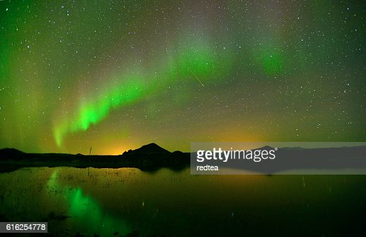 Beautiful northern lights aurora  over lake in Iceland。 : Stock Photo
