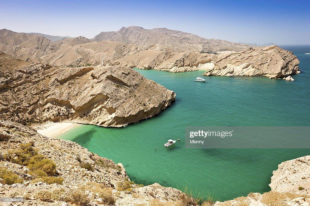 Beautiful Oman Coast Green Lagoon with Hidden Beach