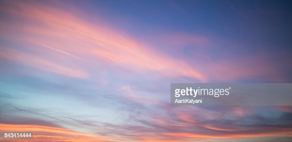 Beautiful pastel cloudy sunset with blue sky in California : Stock Photo