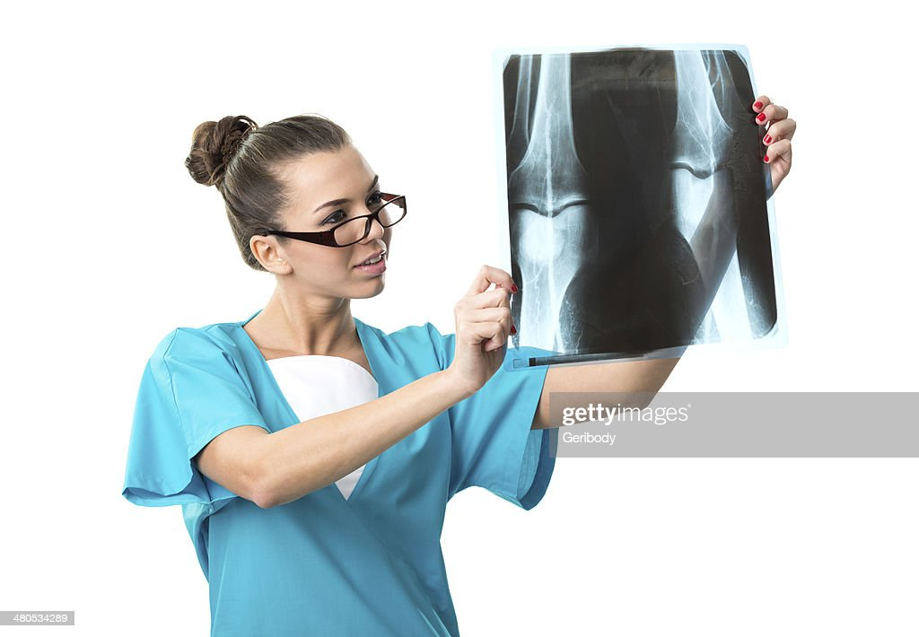 Beautiful radiologist, with X-ray image : Stock Photo