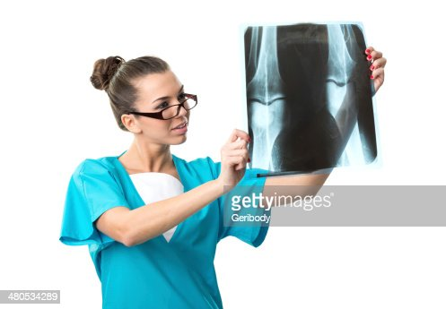 Beautiful radiologist, with X-ray image : Stockfoto