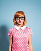 Beautiful red hair young woman wearing polka dot dress