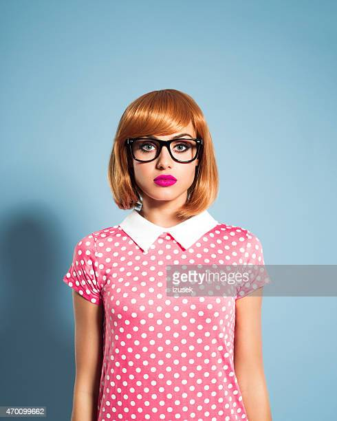 Beautiful red hair young woman wearing polka dot dress