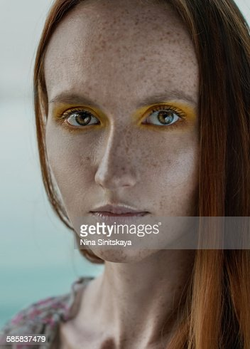 Beautiful red haired girl with freckles