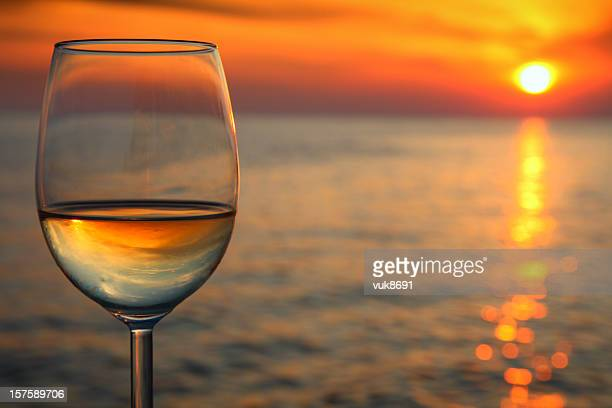 Beautiful red sunset  and glass of wine