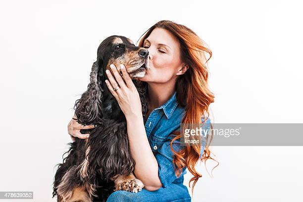 Beautiful redhead woman on her 40s with her dog