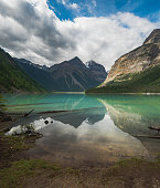 A beautiful reflective view of Kenny Lake in Mt Robson Provincial Park in British Columbia