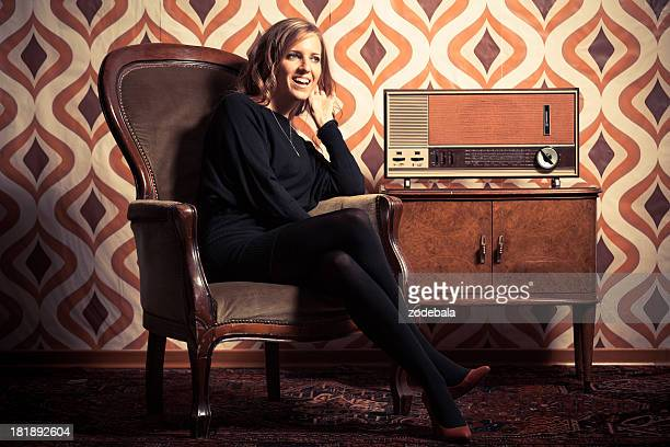 Beautiful Retro Woman Listening News on Vintage Radio