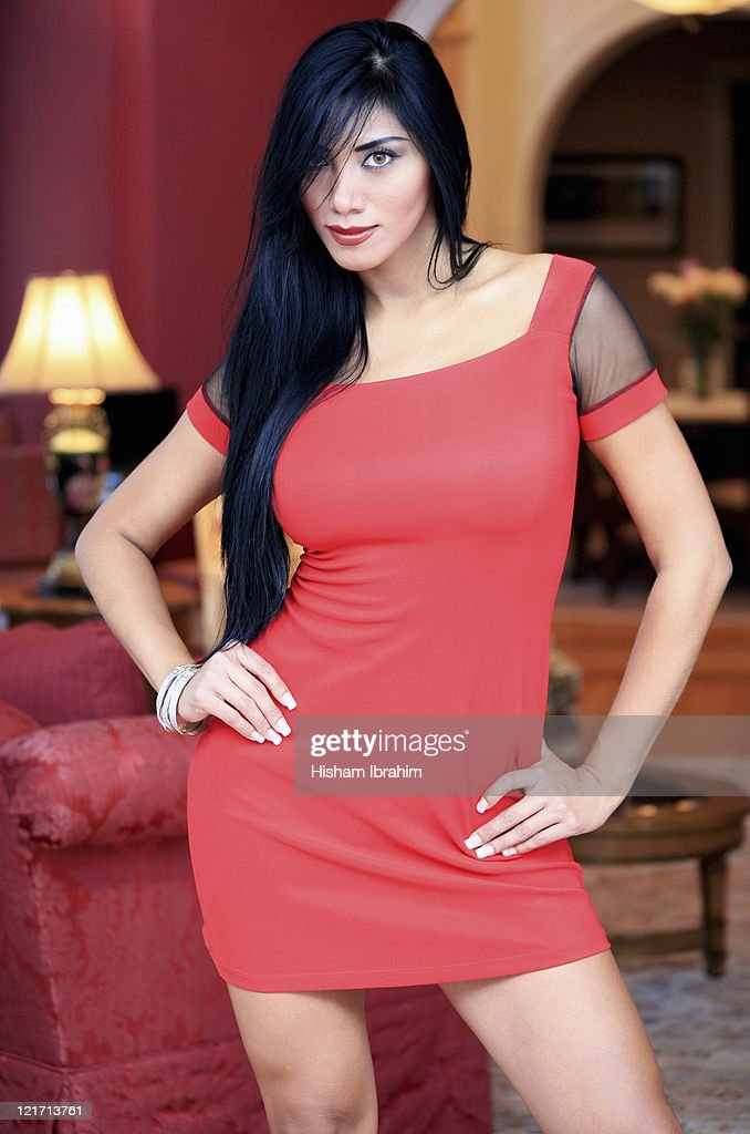 Beautiful rich woman standing in her house : Stock Photo