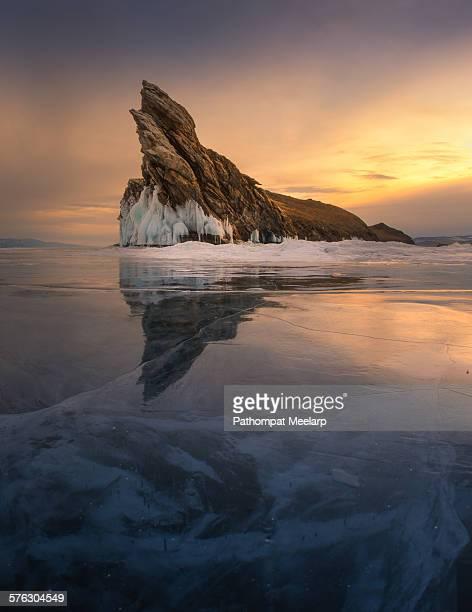 Beautiful rock at Baikal lake with reflection