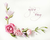 lettering - Good Day written in calligraphy style on paper with wreath frame with roses isolated on white background.