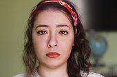 beautiful sad arabic woman looking to camera
