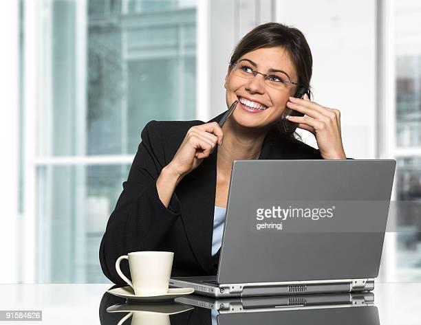 Beautiful secretary with laptop