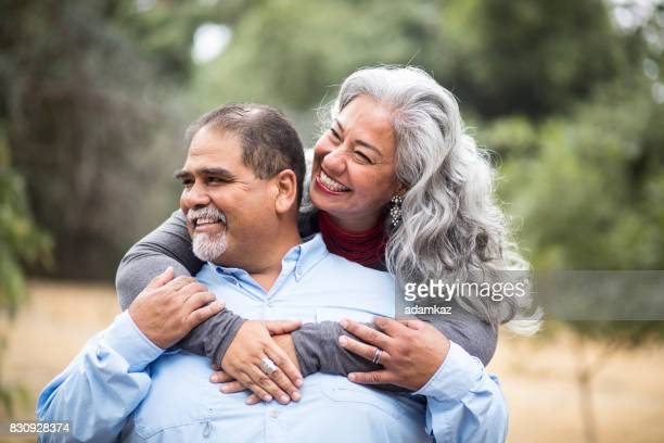 Beautiful Senior Mexican Couple Piggyback Ride