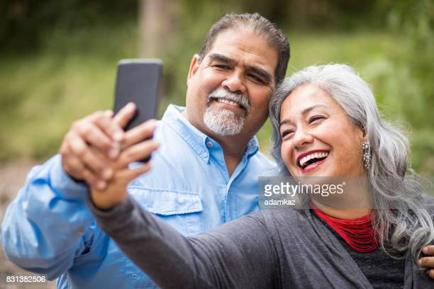 Beautiful Senior Mexican Couple Taking Selfies