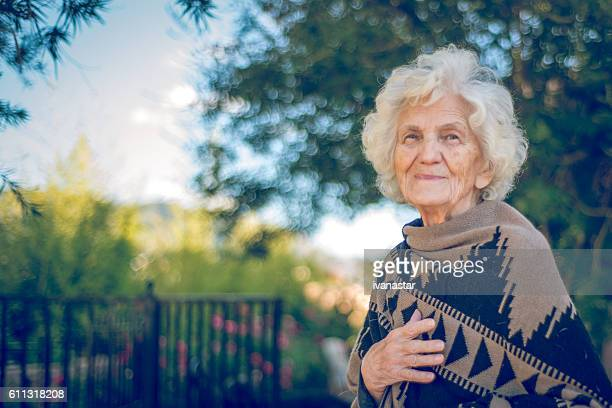 Beautiful Senior Woman Outdoors Wrapped in Alpaca Shawl