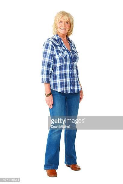 Beautiful senior woman standing on white