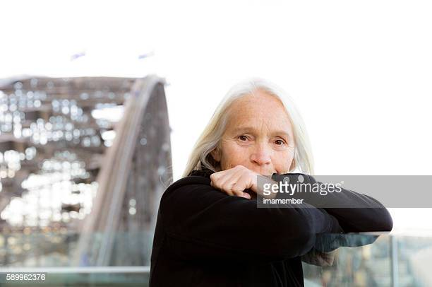 Beautiful senior woman with her hand on mouth, copy space