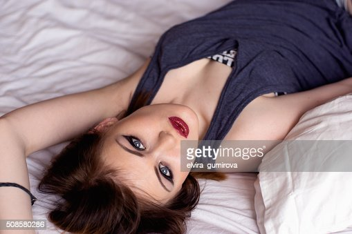 beautiful sexy woman sitting on the bed : Stockfoto