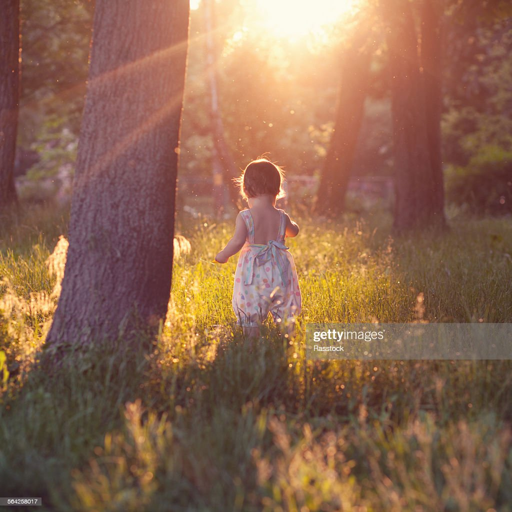 Beautiful shot of walking baby in sunset lights