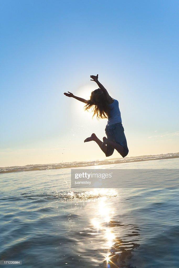Beautiful Silhouette of Jumping Girl