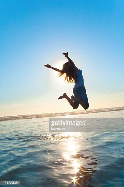Beautiful Silhouette of Jumping Girl