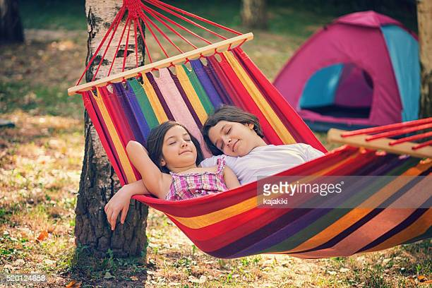 Beautiful Sisters Relaxing Together In The Hammock