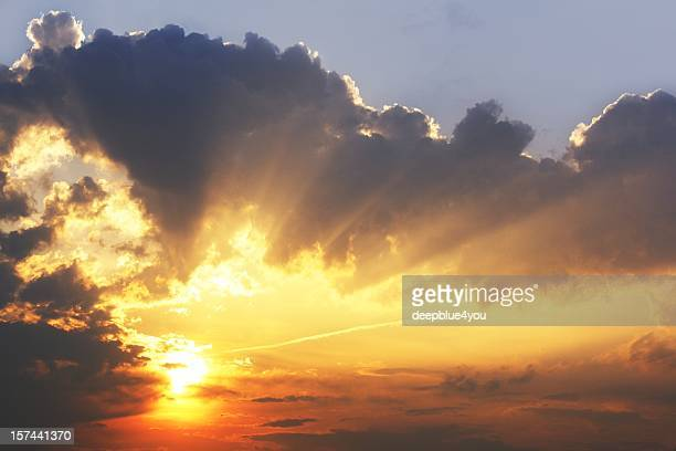 beautiful sky sunrise with sunbeams in dark clouds wallpaper