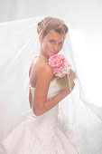 Beautiful smiling bride in the veil with bouquet.XXXL