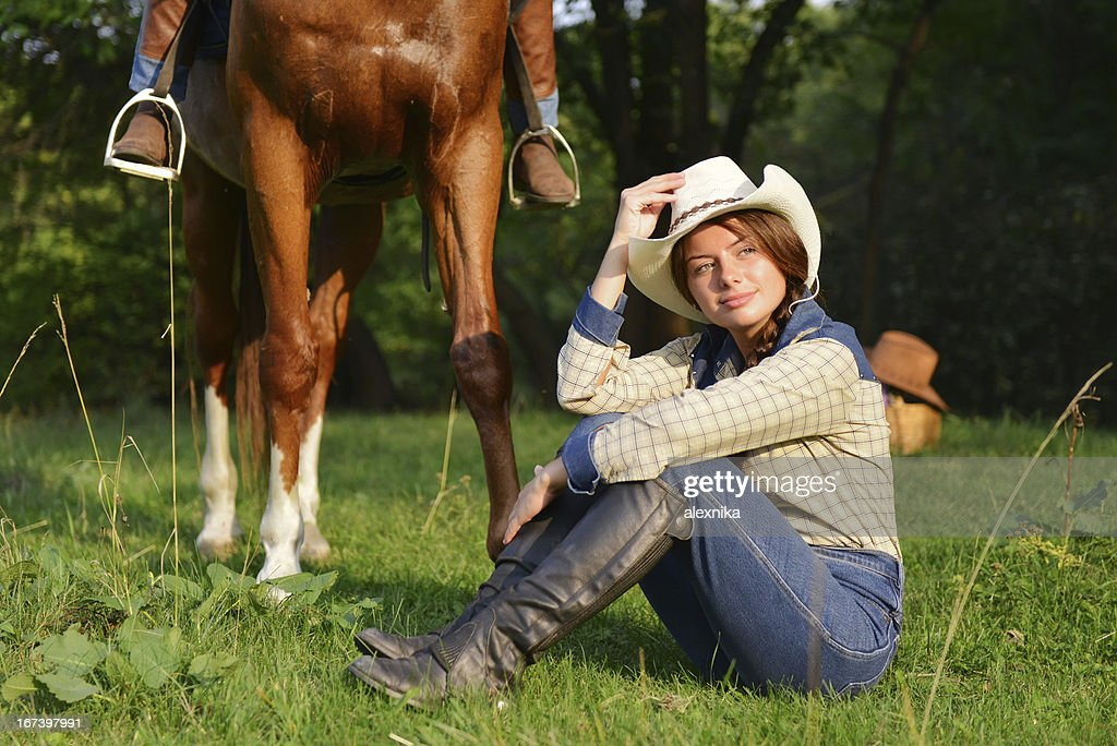 Beautiful Smiling Cowgirl with horse : Stockfoto