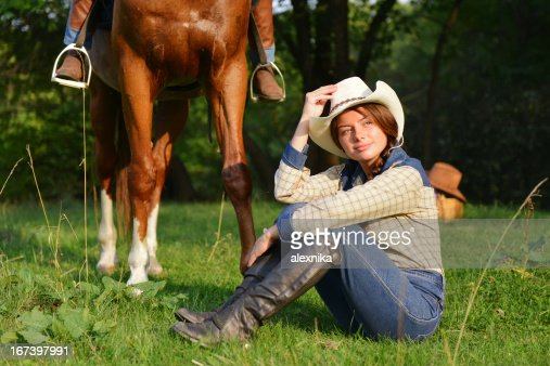 Beautiful Smiling Cowgirl with horse : Bildbanksbilder