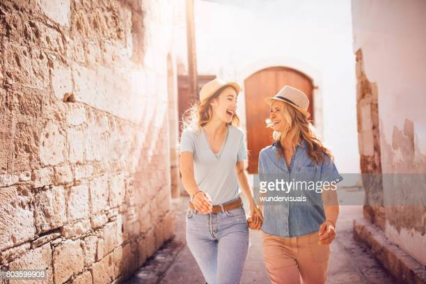 Beautiful smiling grandmother and teenage granddaughter on holidays in Italy