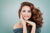 Beautiful Smiling Model Woman with Wavy Hairstyle. Cosmetology and Treatment Concept