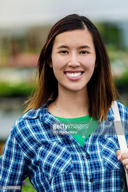 Beautiful smiling Vietnamese Woman in a blue plaid shirt