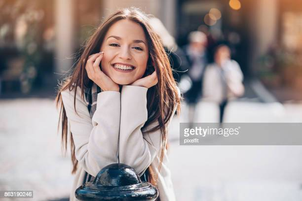 Beautiful smiling woman with braces