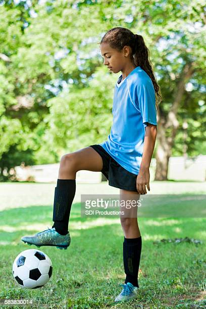 Beautiful soccer player kicks ball