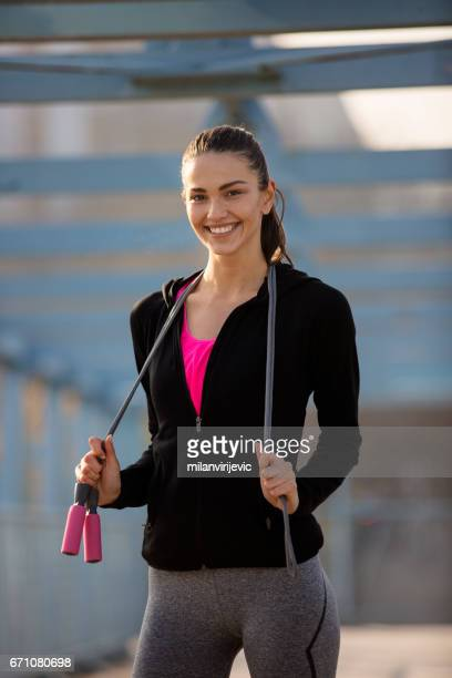 Beautiful sports woman with skipping rope