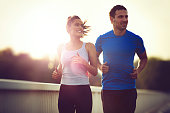 Beautiful sporty couple running and jogging outdoors