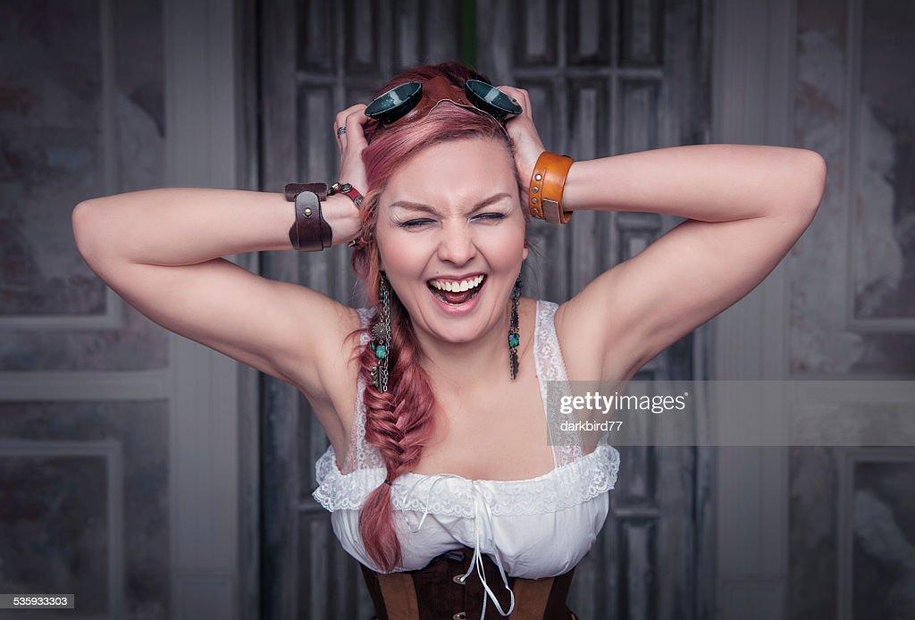 Beautiful steampunk woman in corset screaming : Stock Photo