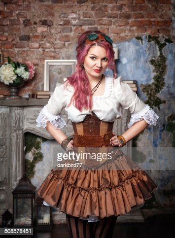 Beautiful steampunk woman posing : Stock Photo