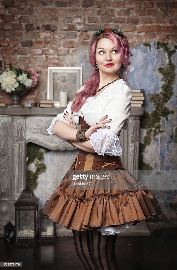 Beautiful steampunk woman posing : Stock Photo