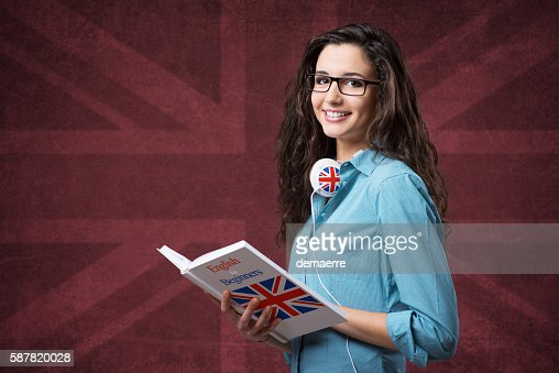 Beautiful student girl posing with notebooks : Stock Photo