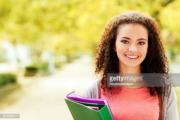 Beautiful Student With Ring Binders Smiling On Campus