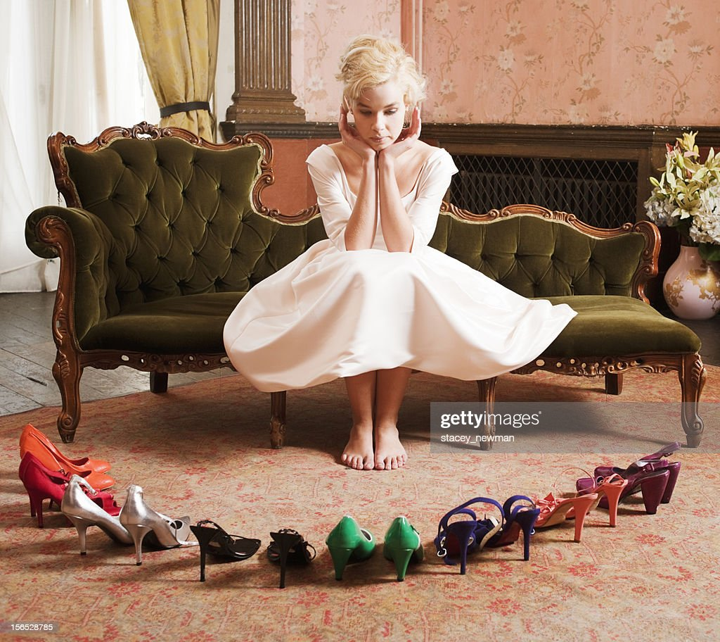 Beautiful, Stylish Woman Choosing Shoes