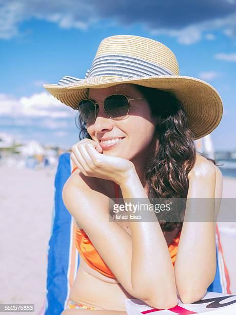 Beautiful stylish woman on the beach