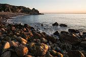 Beautiful sunrise landscape image of Church Ope Cove in Dorest England